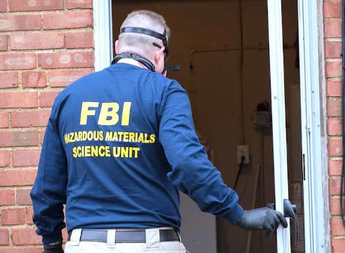 A member of the FBI's hazmat team | Credit: crowdfundinsider