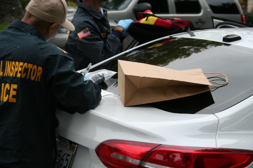 Members of the J-CODE team conduct a search of a residence and vehicle in California in March 2019, where drugs were among the items seized.