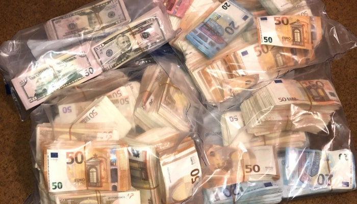 A picture of Police seized hundreds of thousands of dollars in cash during the investigation