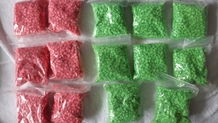 A picture of Police seized the ecstasy pictured above during a raid at a related drug lab last year.